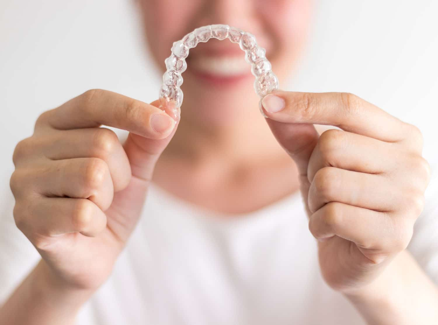 Woman holding Invisalign Braces